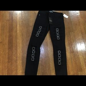 Black jeans with leg buckle design